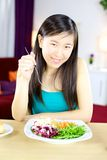 Cute asian woman at home on a healthy diet Stock Photography