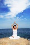 Cute Asian Woman Meditating. Asian woman meditating at beach Royalty Free Stock Photos