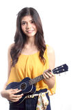 Cute asian woman playing ukulele Stock Photo