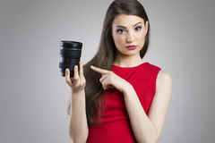Cute asian woman pointing at camera lens Stock Photo