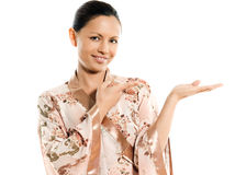 Cute Asian woman showing invisible product Royalty Free Stock Image