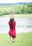 Cute asian women playing yoga at the river,peaceful place,natura Stock Images