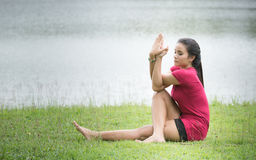 Cute asian women playing yoga at the river,peaceful place,natura Stock Image