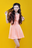 Cute asian young  girl. Portrait on yellow Royalty Free Stock Image