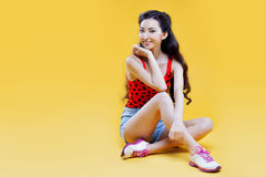 Cute asian young  girl. Portrait on yellow Stock Photos