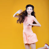 Cute asian young  girl waving to someone. Portrait Royalty Free Stock Photo