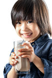 Cute asian youngster drinking chocolate milk. Stock Photography