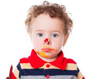 Cute astonished baby boy playing with paints Royalty Free Stock Photos
