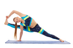 Cute athlete doing difficult stretching exercise Royalty Free Stock Photography