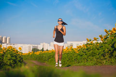 Cute athlete on morning jog in the field Stock Photography