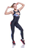 Cute athletic girl posing in the studio isolated on white background. Young woman bodybuilder or fitness coach wearing sportswear Royalty Free Stock Image