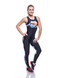 Cute athletic girl posing in the studio isolated on white background. Young woman bodybuilder or fitness coach wearing sportswear Royalty Free Stock Photography