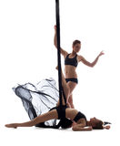 Cute athletic girls dancing with silk ropes Royalty Free Stock Images