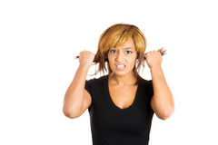 Cute attractive woman going crazy, pulling her hair out Stock Images