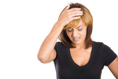 Cute attractive woman having a bad headache, placing hand on head Royalty Free Stock Photo