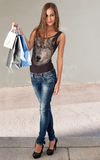 Cute attractive young shopper. Stock Image