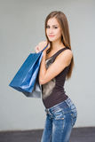 Cute attractive young shopper. Stock Images