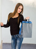 Cute attractive young shopper. Royalty Free Stock Photos