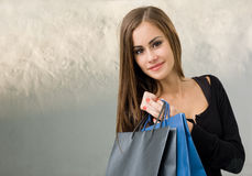 Cute attractive young shopper. Stock Photos
