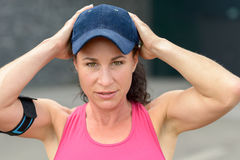 Cute attractive young woman in a baseball cap royalty free stock image