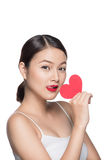 Cute attractive young woman with red heart. Valentine`s day art stock photos