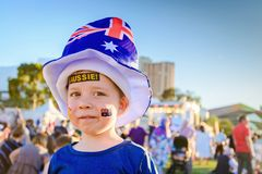 Cute Australian boy with tattoos on his face. Cute Australian boy with Aussie tattoos on his face on Australia Day celebration in Adelaide royalty free stock photo