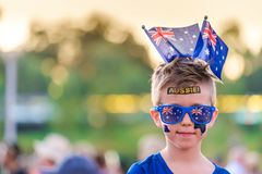 Cute Australian boy with flags and tattoos on his face. Cute Australian boy with flag tattoos on his face on Australia Day celebration in Adelaide royalty free stock photography