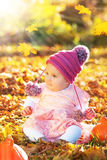 Cute autumn baby girl in golden soft light
