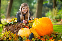 Cute autumn girl smiling Stock Images