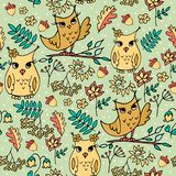 Cute autumn seamless pattern with owls. Forest pattern with rowan and flowers on light green background royalty free illustration