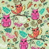 Cute autumn seamless pattern with owls. Forest pattern with rowan and flowers on light green background vector illustration