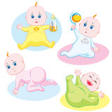 Cute babies. Four cute babies playing and smiling Stock Photo