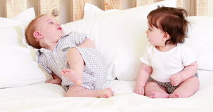 Cute babies on a bed stock video footage