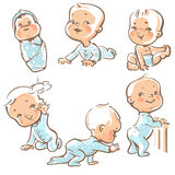 Cute babies in blue clothes. Stock Photo