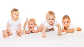 Cute babies crawl in a row wearing white bodysuit. On the white background stock photo