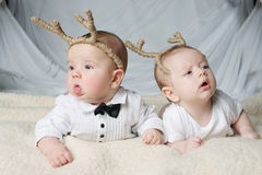 Cute babies with deer horns Royalty Free Stock Photo