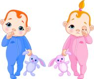 Cute babies going to sleep Stock Image