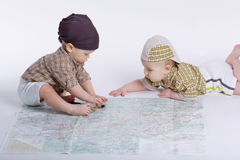 Cute babies planning travel with map Stock Photo