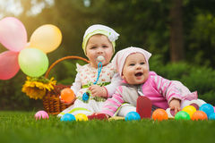 Cute babies are playing on the green grass Stock Photo