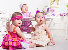 Cute babies. Beside white wooden bench stock photography