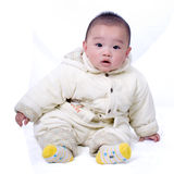 Cute baby. A baby sitting on the white background Royalty Free Stock Photos