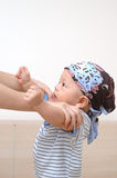 Cute baby. It is a cute chinese baby, he is standing by mother's help, he is 8 months old Royalty Free Stock Photography