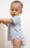Cute baby. It is a cute chinese baby, he is starting to stand up, he is 8 months old Royalty Free Stock Photography