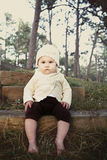 Cute baby. Sitting on outdoor steps Royalty Free Stock Images