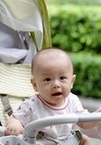 Cute baby. It is a cute chinese baby in the baby carriage Royalty Free Stock Photography