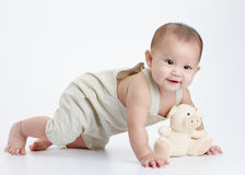 Cute baby. Cute little baby play alone, studio shot Stock Images