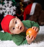 Cute baby. Holding a red apple Royalty Free Stock Photography