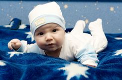 Cute Baby. Beautiful little baby portrait on blue background royalty free stock photography
