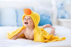 Free Cute Baby After Bath In Yellow Duck Towel Royalty Free Stock Photo - 100417575