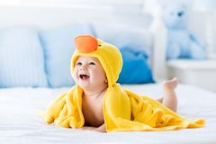 Free Cute Baby After Bath In Yellow Duck Towel Stock Images - 101192084